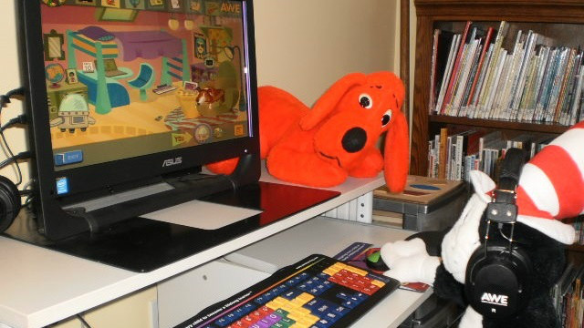Our library friends have fun with the AWE computer.